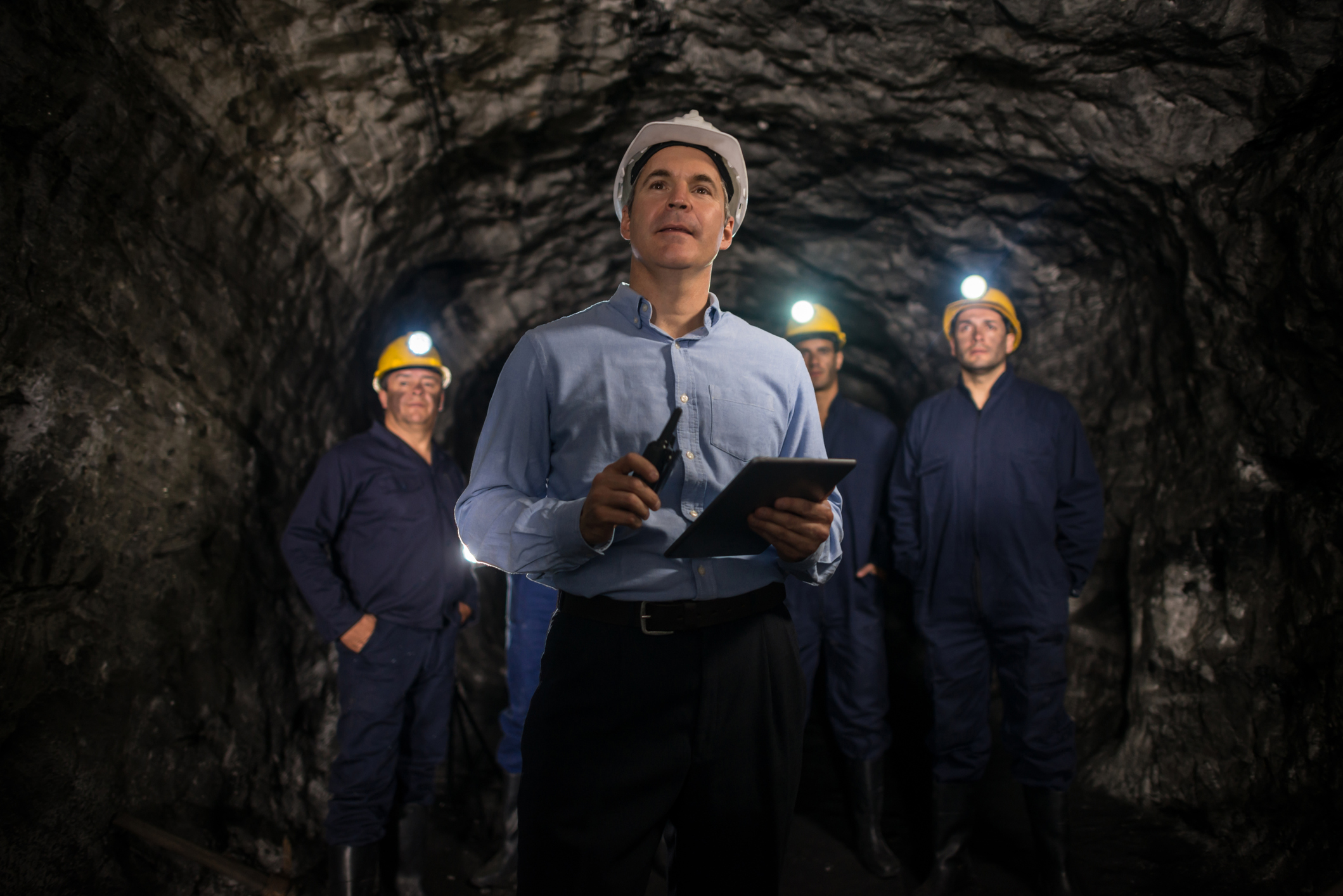 Engineer leading a group of miners