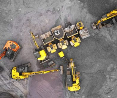 Construction site diggers yellow and orange aerial view from above