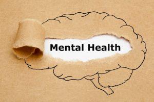 Mental Health Brain Torn Paper Concept